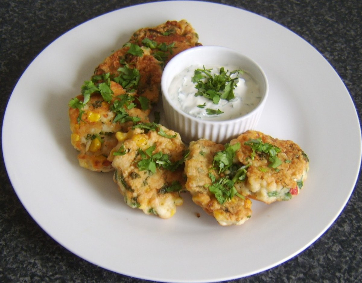 Chicken, sweetcorn and bell pepper fritters, served with a soured cream and garlic dip