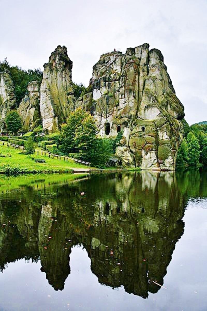 Externsteine reflected on the man-made lake. Photo by Daniel Schwen