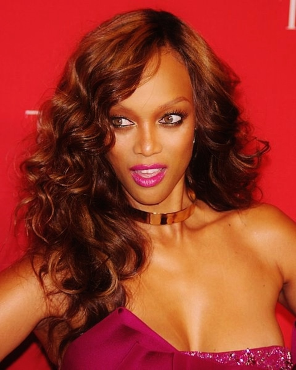 Tyra Banks in curly weave.  Red hair for African American women.
