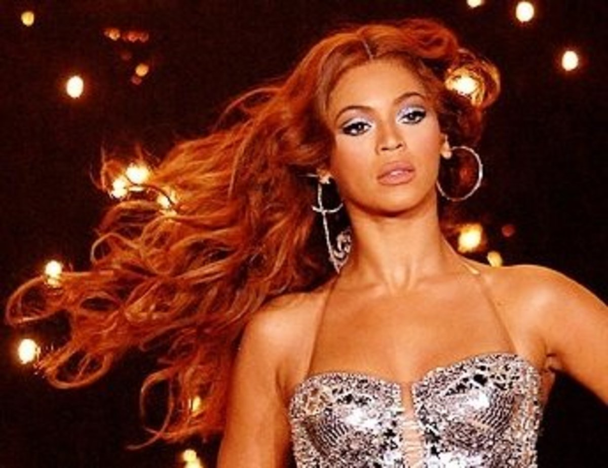 Beyonce in auburn hair. Celebrity black women with red hair.
