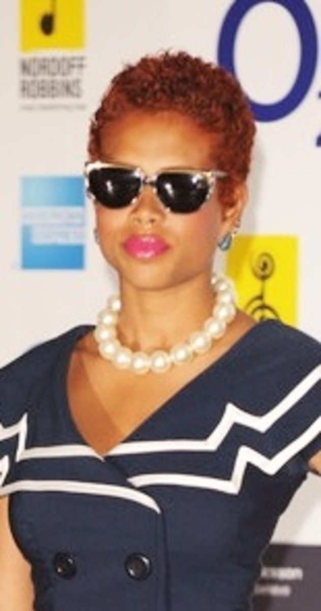 Kelis in short ringlets. Celebrity black women with red hair.