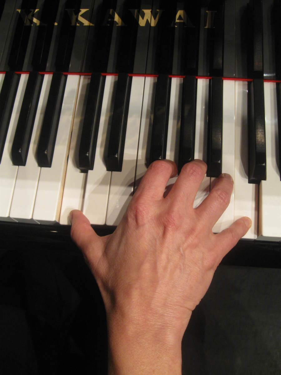 The same woman's hand playing an octave on a 15/16th piano. Note the more relaxed hand position playing the same notes on the slightly smaller 15/16th prototype Kawai piano keyboard made for pianist and teacher Erica Booker in Sydney, Australia.