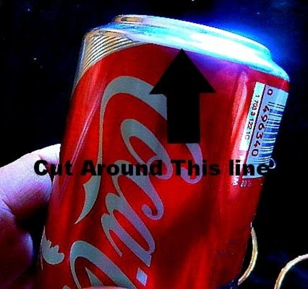 Cut the bottoms off of both of your soda cans.