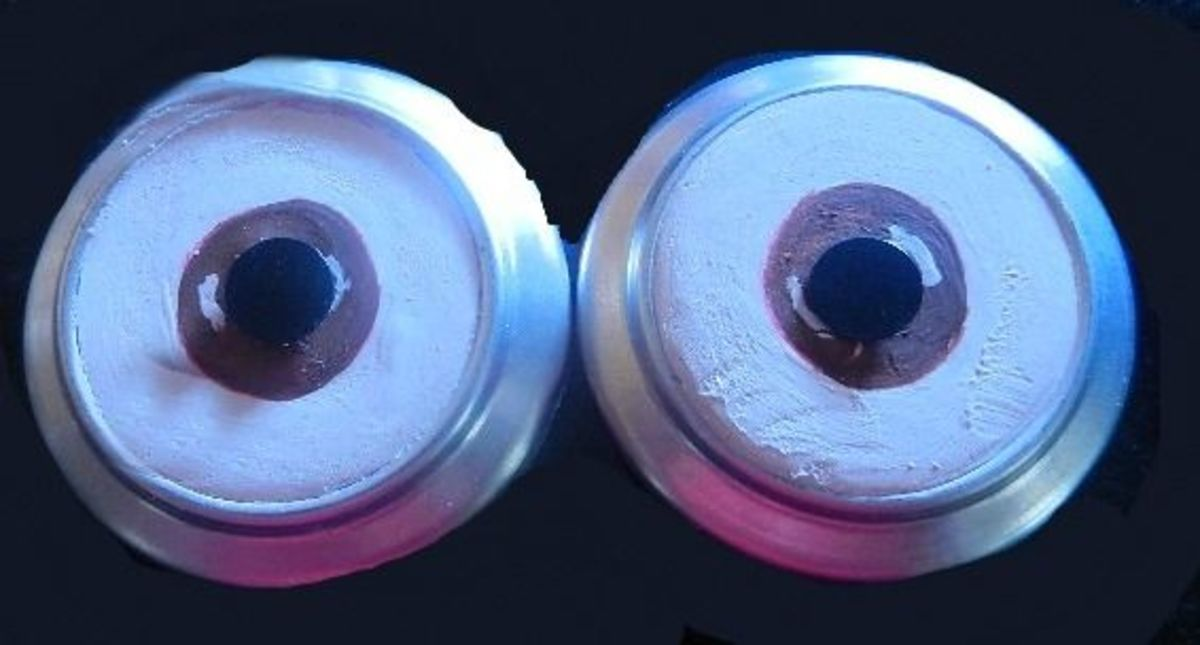 Now connect the two goggle lenses by gluing them to a black ribbon.