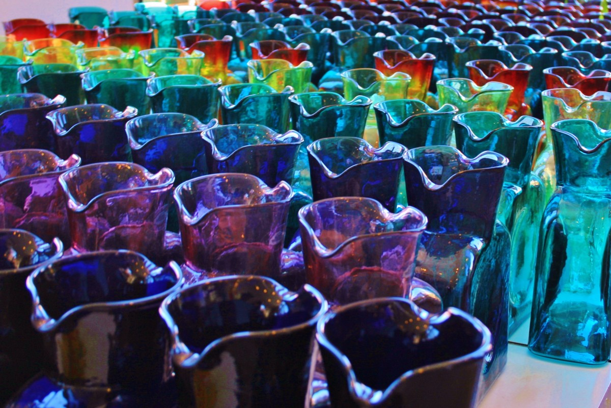 Blenko water bottles are reasonably priced, many at less than $20. Pictured: an array of carafes in the Blenko gift shop.