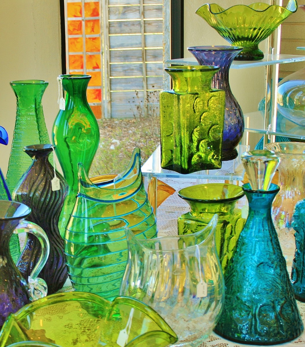 Another shot of a gorgeous display in the gift shop. Notice the aqua decanter. While the decanter itself is hand blown, the stopper is pressed.