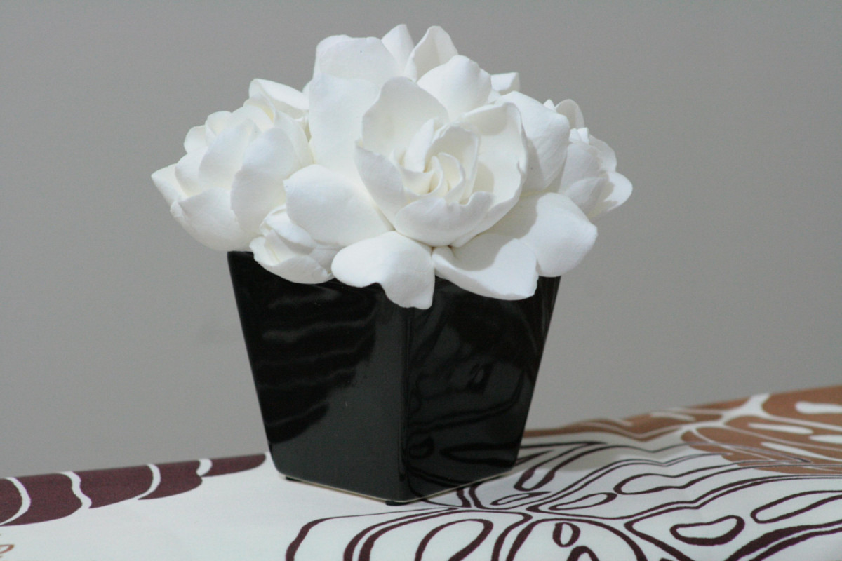 Bring your gardenia inside and make an arrangement to take full advantage of its sweet fragrance.