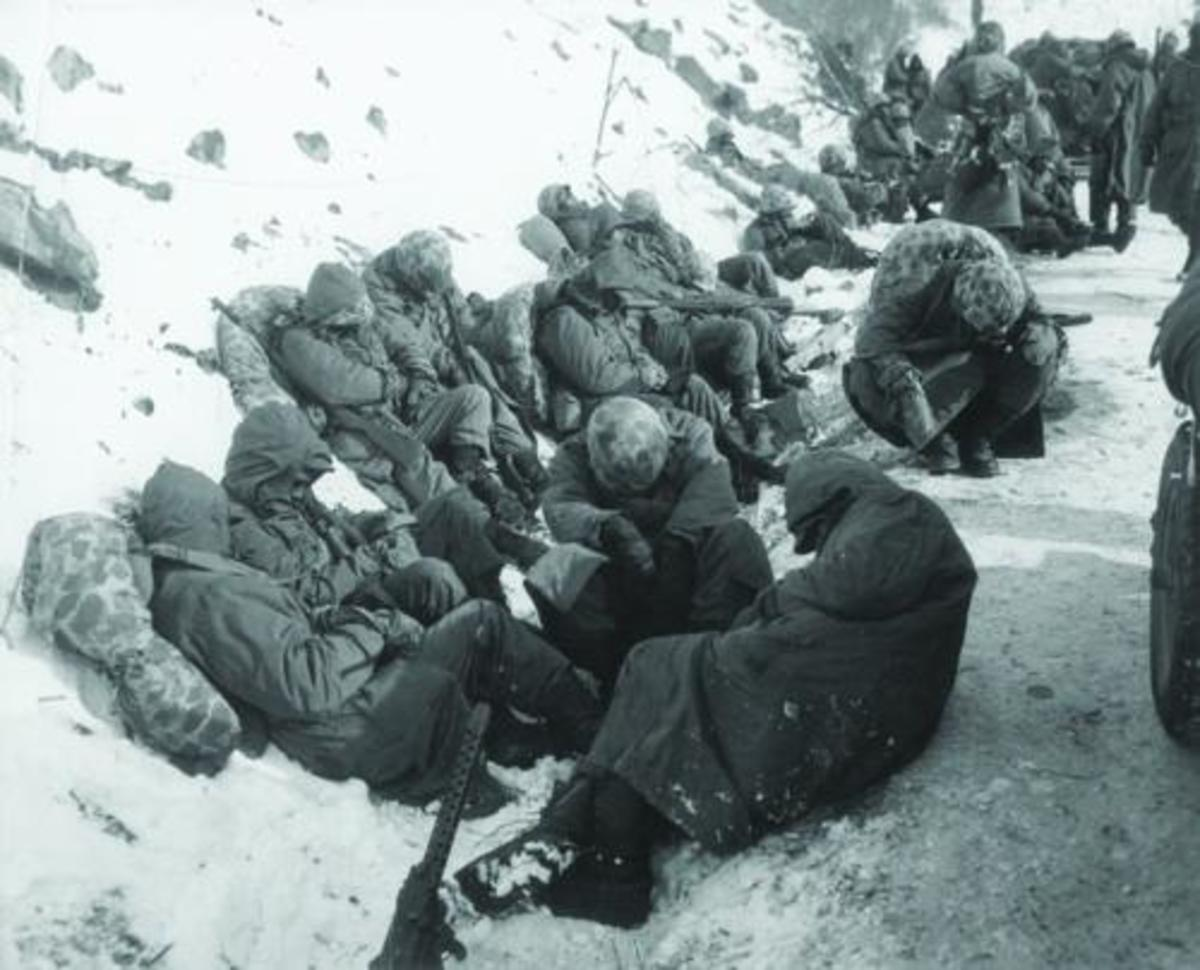 Exhausted Marines tried to get some rest despite the extreme cold.