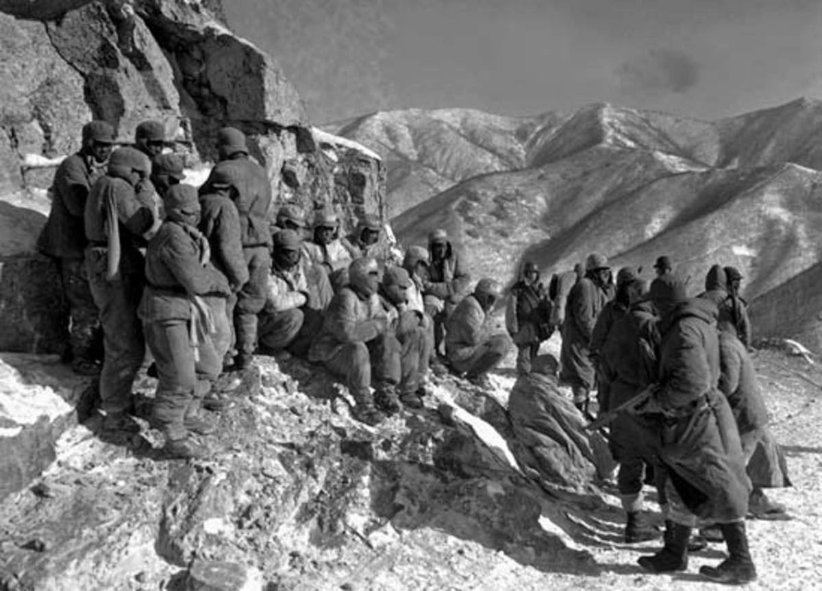 Chinese Prisoners being guarded along the trek.