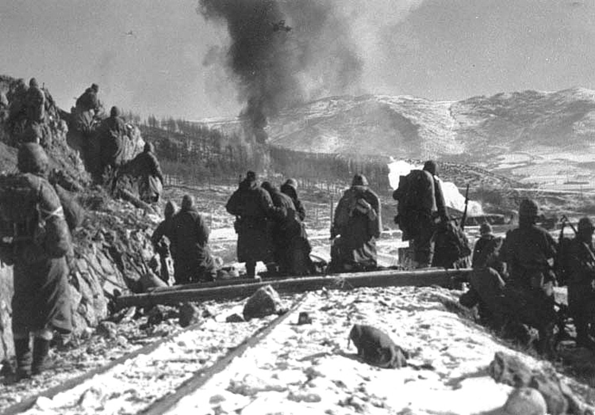 Marines watch a napalm strike on a Chinese position.