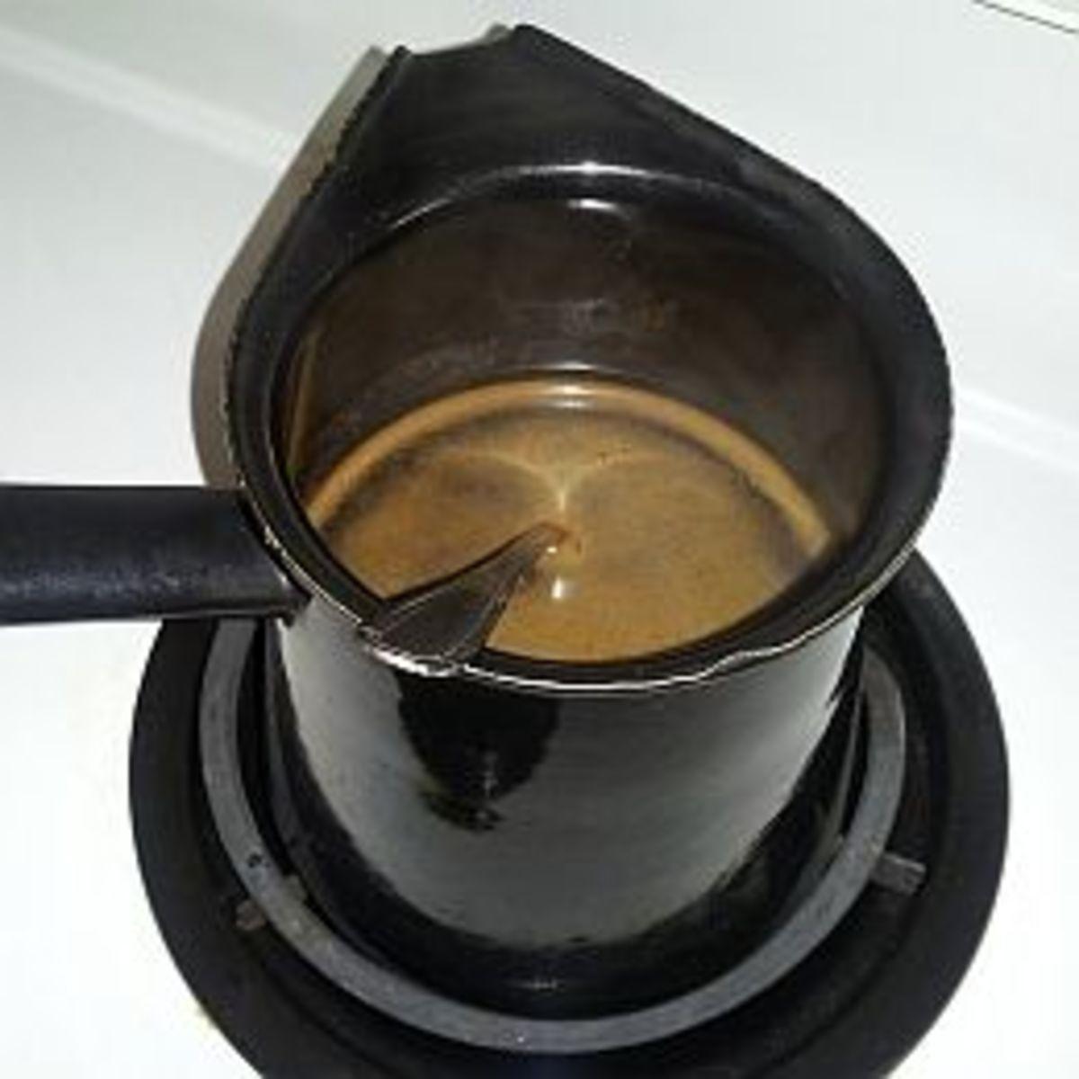 Coffee Ibrik on the Stove - Credit Dorian Bodnariuc
