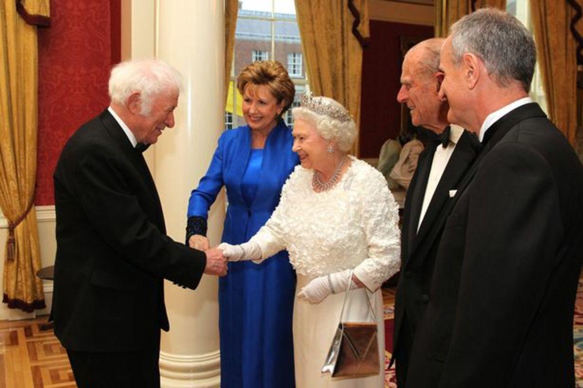 Seamus Heanley meeeting Queen Elizabeth II.