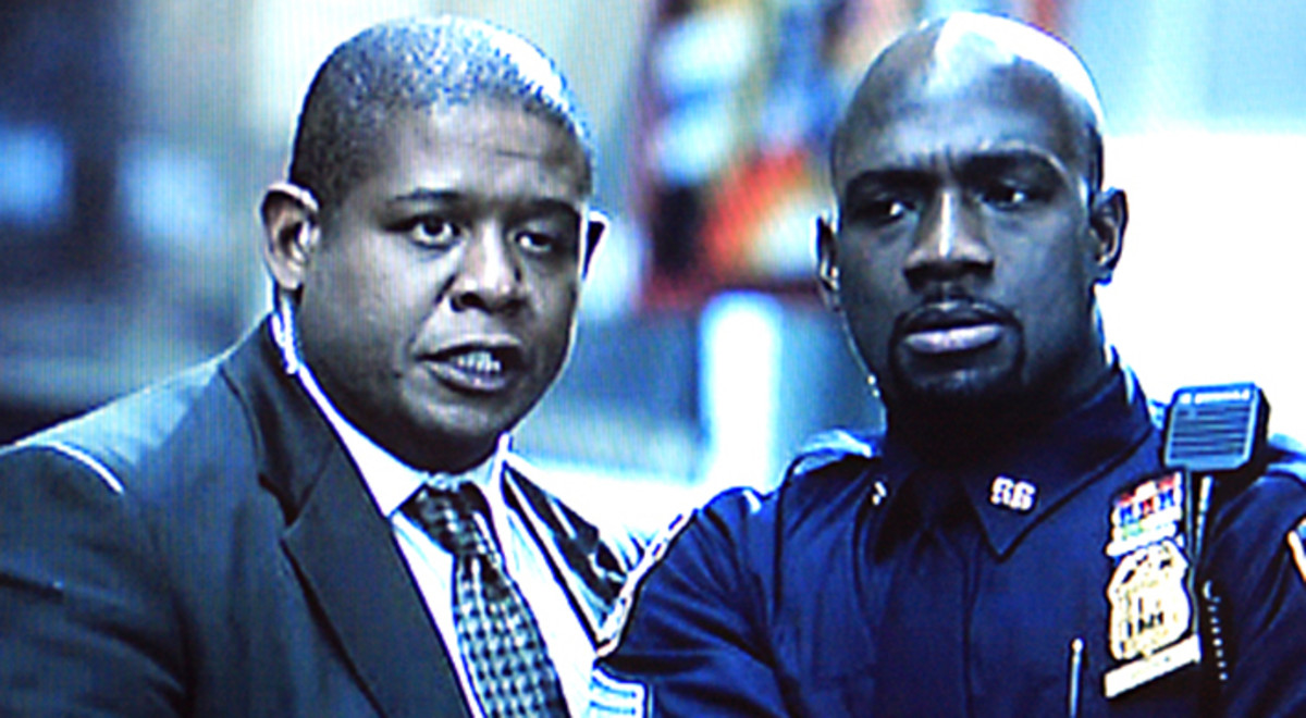 Captain Ramey and Sergeant Cole (Richard T Jones) discuss the developing situation