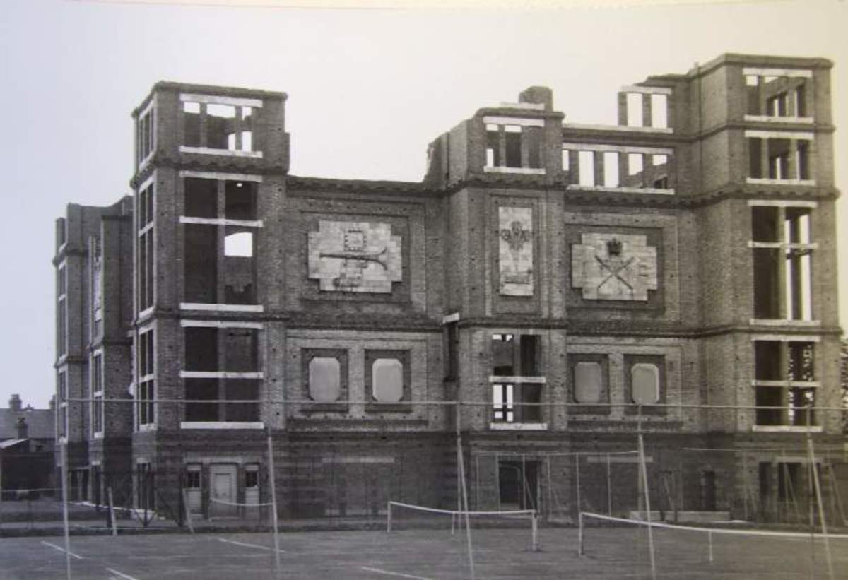 Partly demolished tower remained in this form until 1961