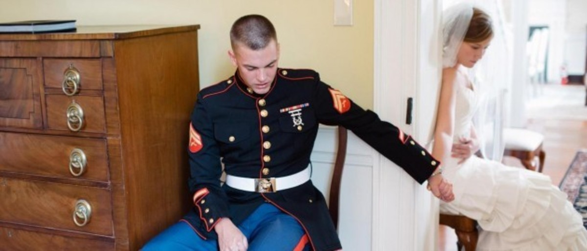 Marine  and his bride praying.