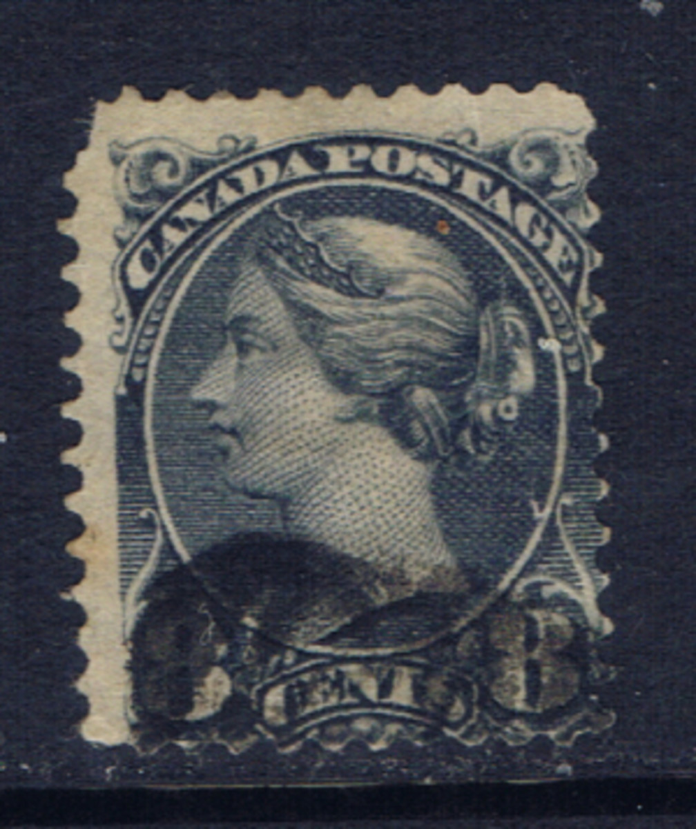 This stamp from Canada shows a heavy cancel and is off-center.  The perforations on the right side are cut into the design.  Still collectible if you cannot find a better copy at a decent price.