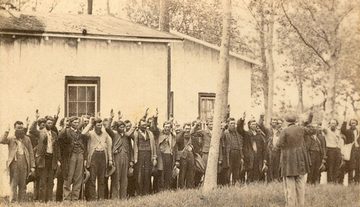 Recruits t(in this interesting case, Confederate Prisoners of War) ake the oath of muster.