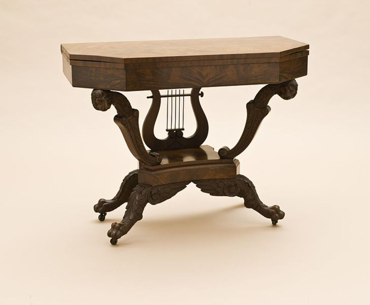 A very unique card table, made from mahogany, ash and pine wood.