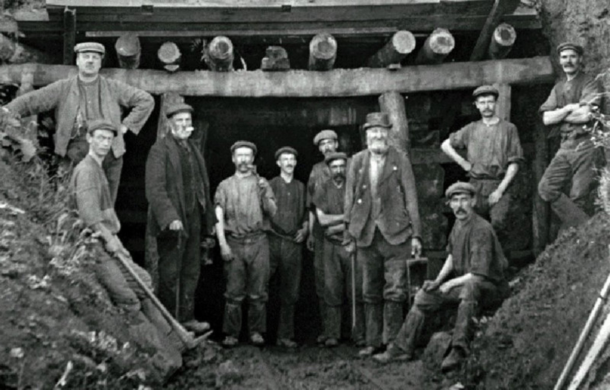 A group of Belmont miners poses for the camera - possibly on the last day of working