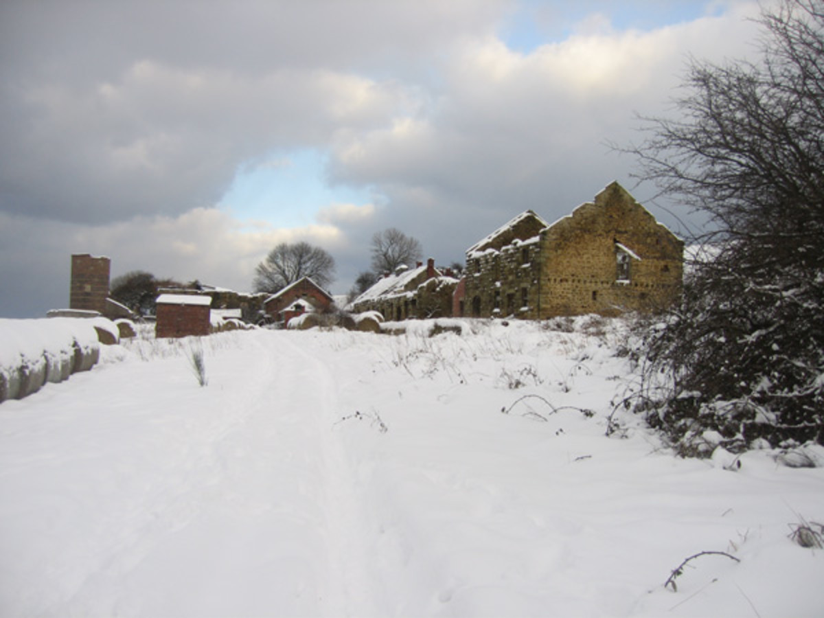 Abandoned, sorry-looking Slapewath buildings stand in winter snow awaiting an uncertain future