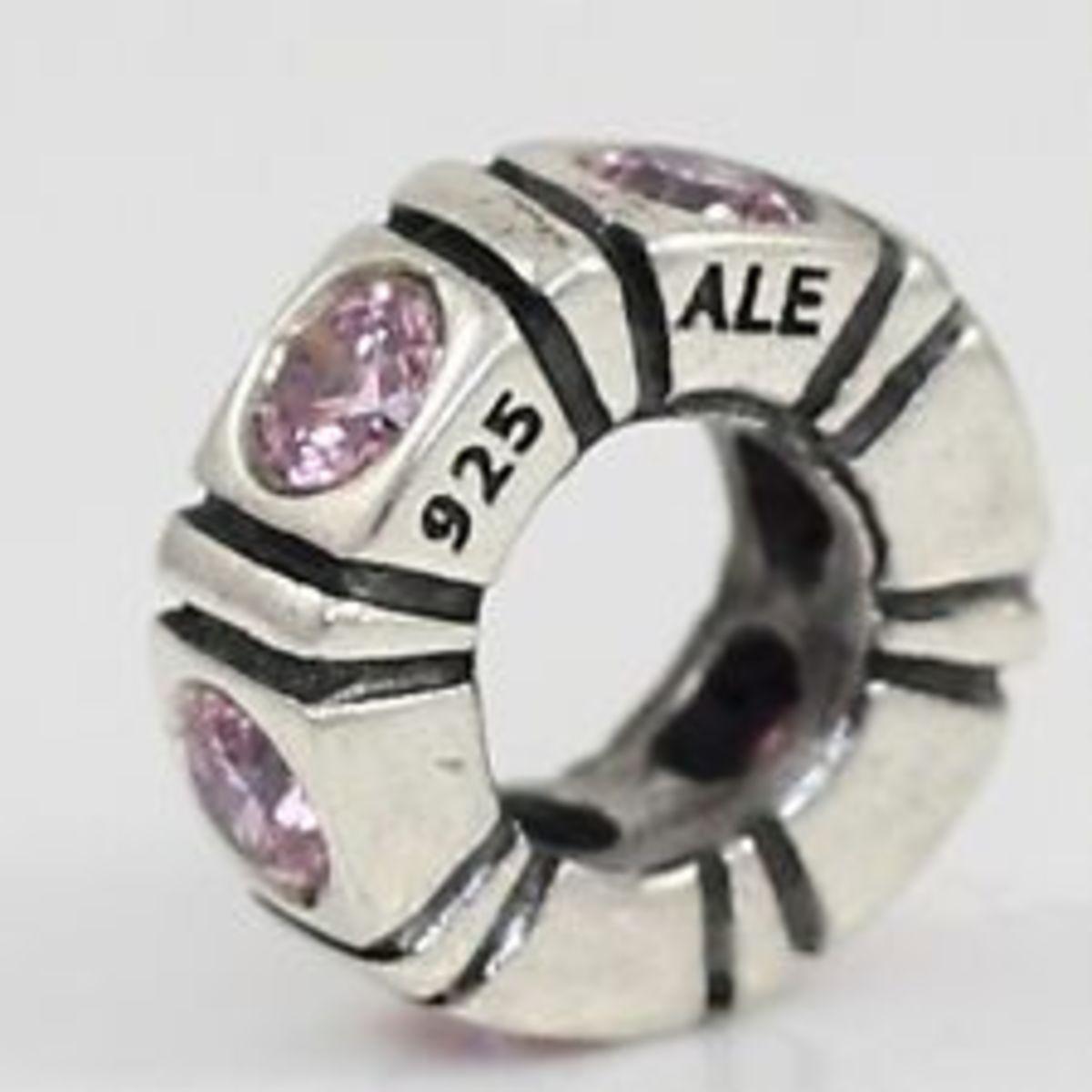 """The """"ALE"""" engraved hallmark on genuine Pandora beads."""