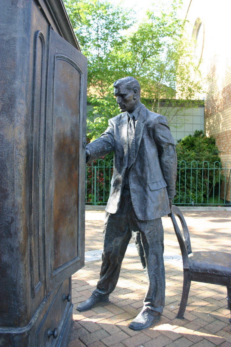 "Statue of C.S. Lewis looking into a wardrobe. Entitled ""The Searcher,"" by Ross Wilson. It stands in Belfast, Ireland where Lewis was born."