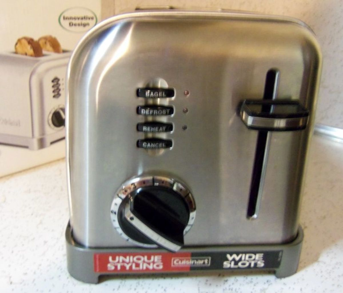 Notice the four settings, dial number for shade of toast and the heavy push down tab.
