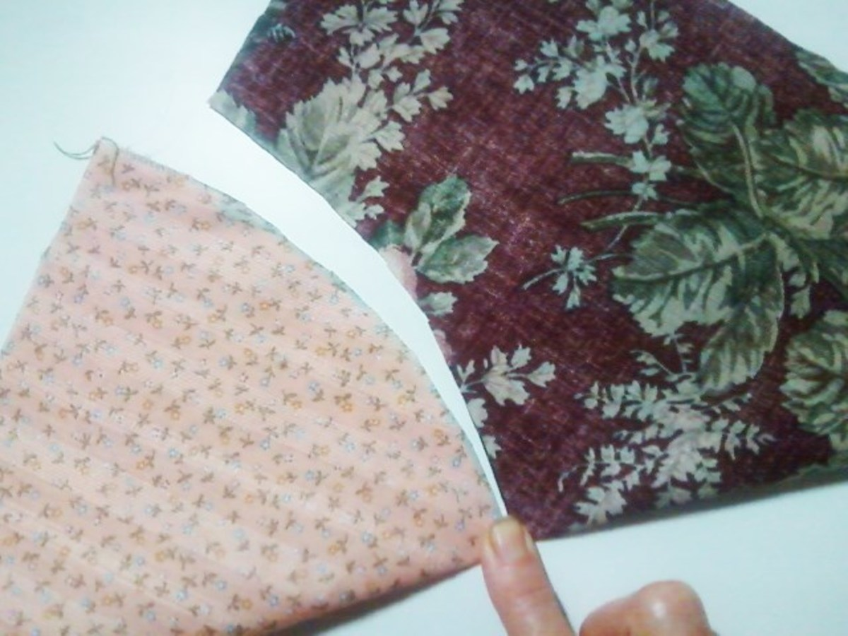 Each piece has been folded in half, raw edges of each piece matching with itself. I press the fabric with my finger to create a crease that I will use as a reference point when pin basting the two fabrics together.