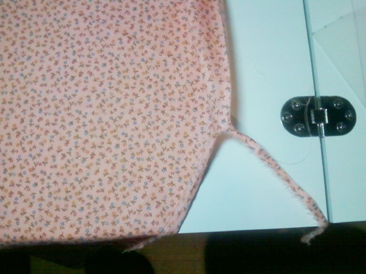 I have snipped the selvage from the fabric and begun the tearing process.