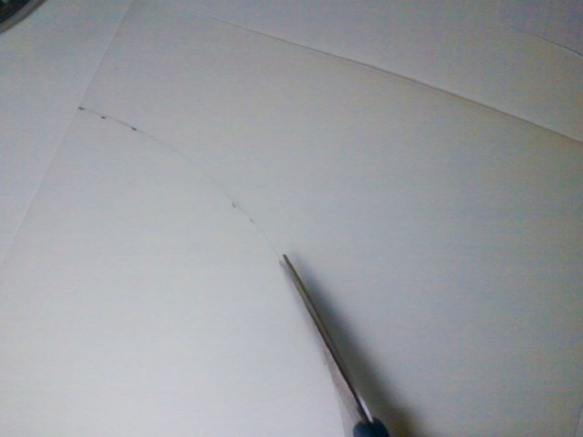 Cutting the vinyl template with utility scissors.
