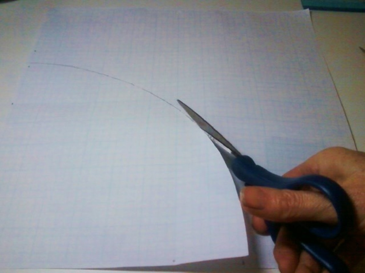 Cut the paper along the constructed curve with utility scissors.