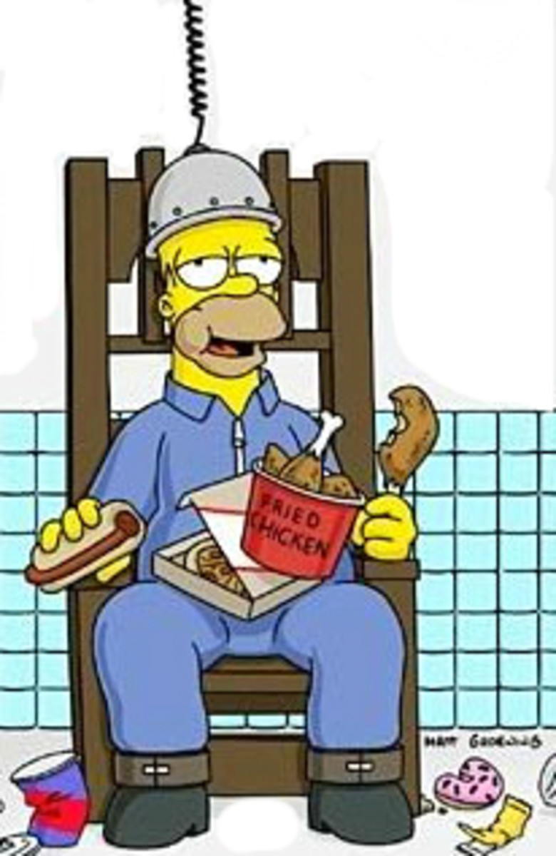 Pictured: Homer Simpson, hooked up to an electric chair, stuffing his face.