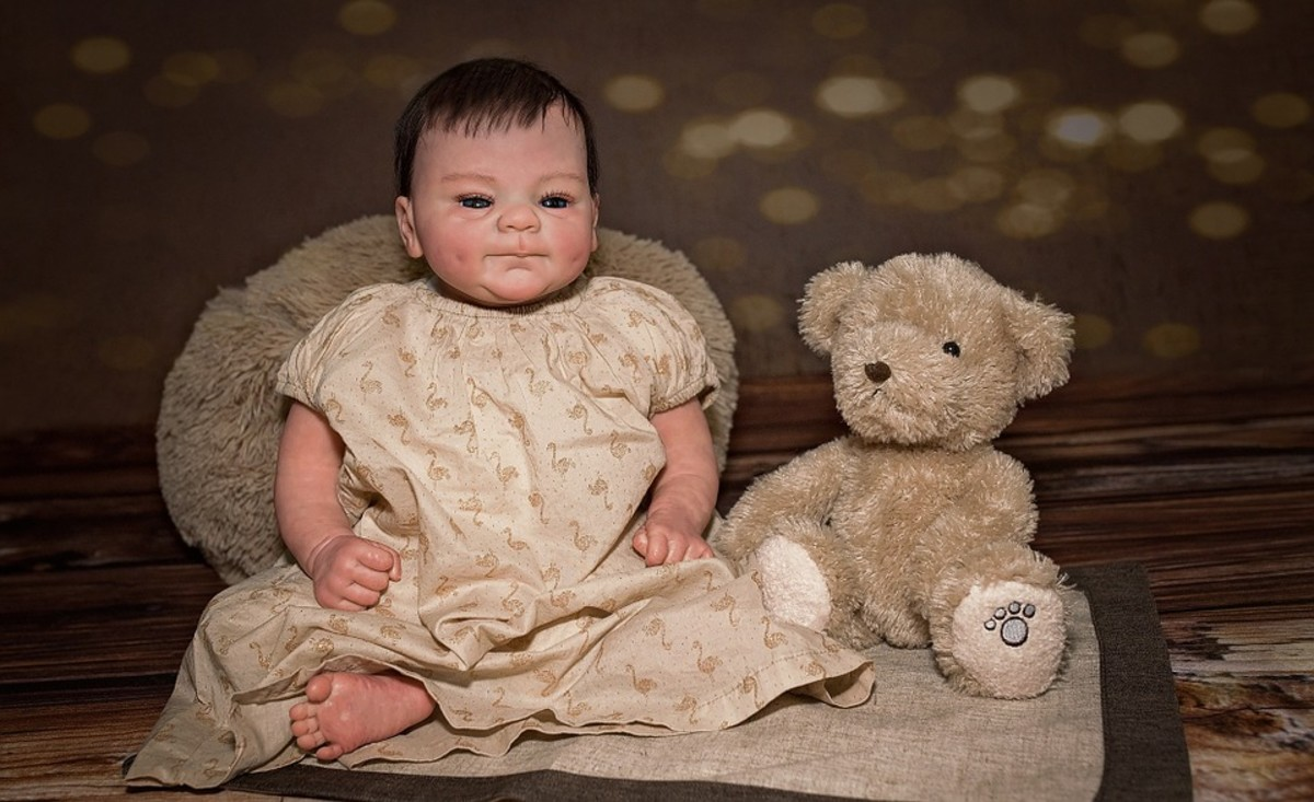 Baby and teddy bear.