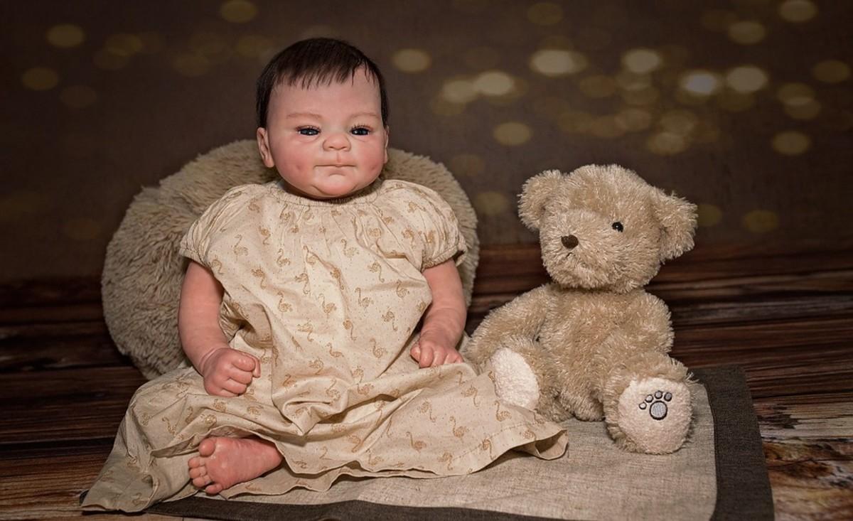 Baby and teddy bear.