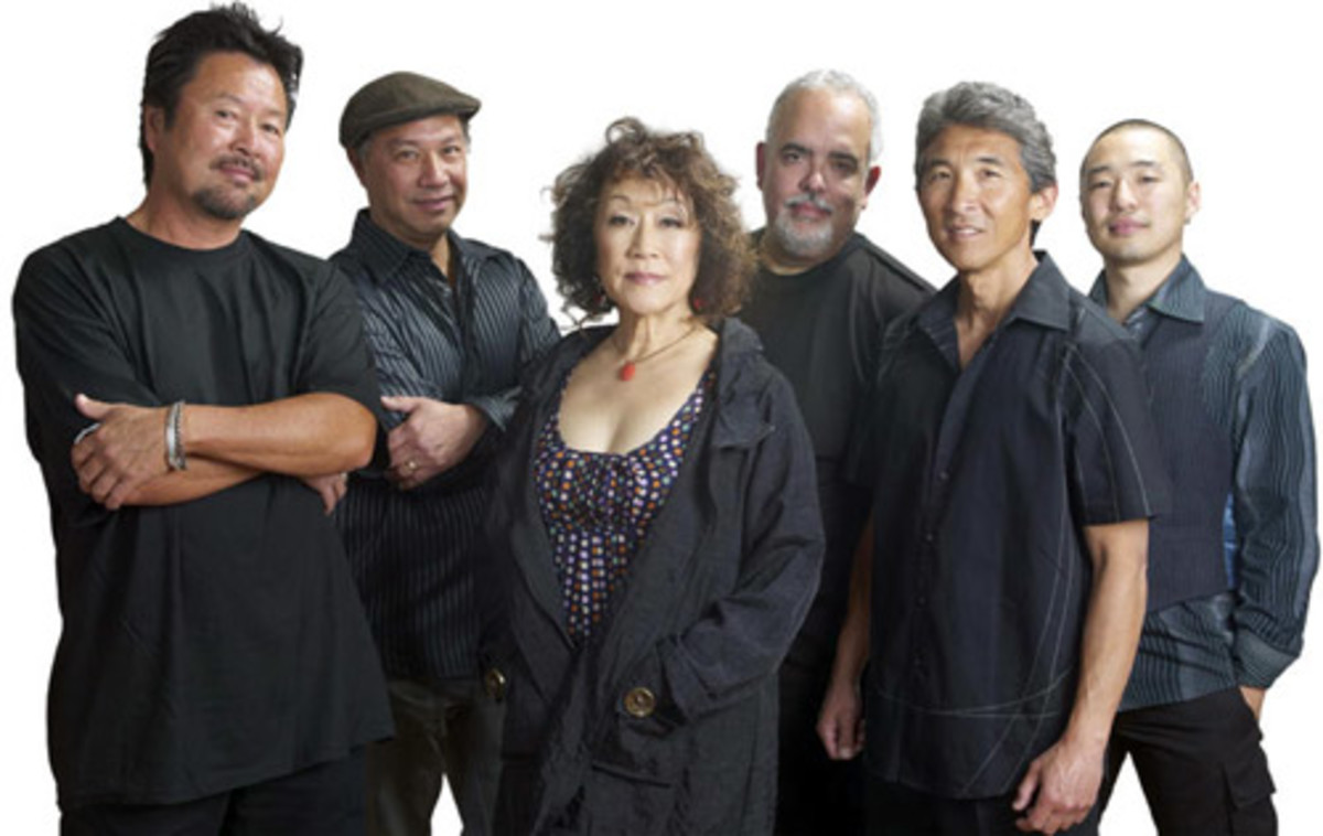 If you already listened to Hiroshima's music, you will know that they combine smooth jazz with the natural sound of the koto (a long Japanese multi-stringed instrument), which is performed by June Kuramoto. Hiroshima's multi-instrumentalist and co-fo