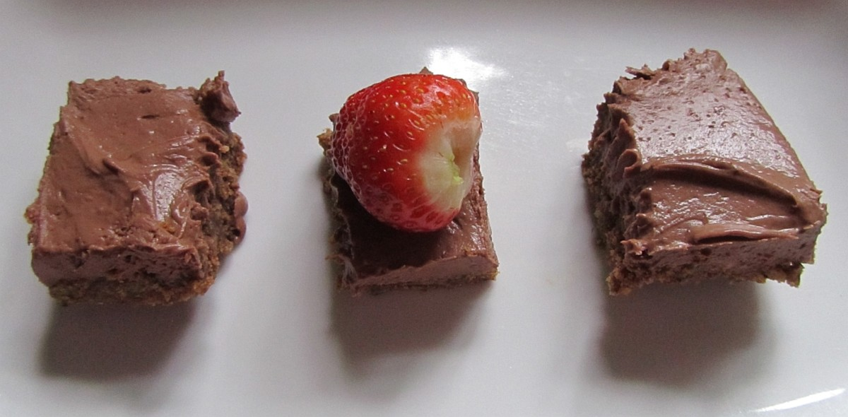 Vegan and wheat free chocolate cheesecake with strawberries.
