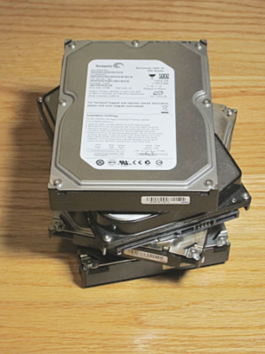 A pile of used hard drives possibly full of confidential information.