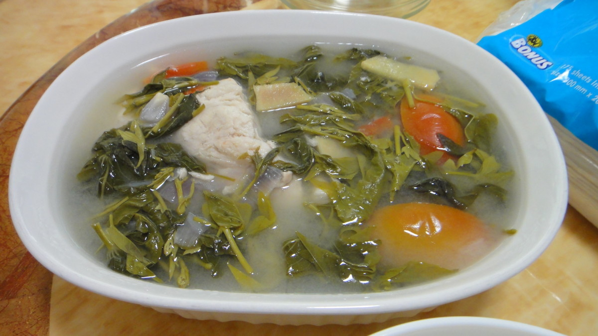 Filipino dish sinigang with sweet potato tops.