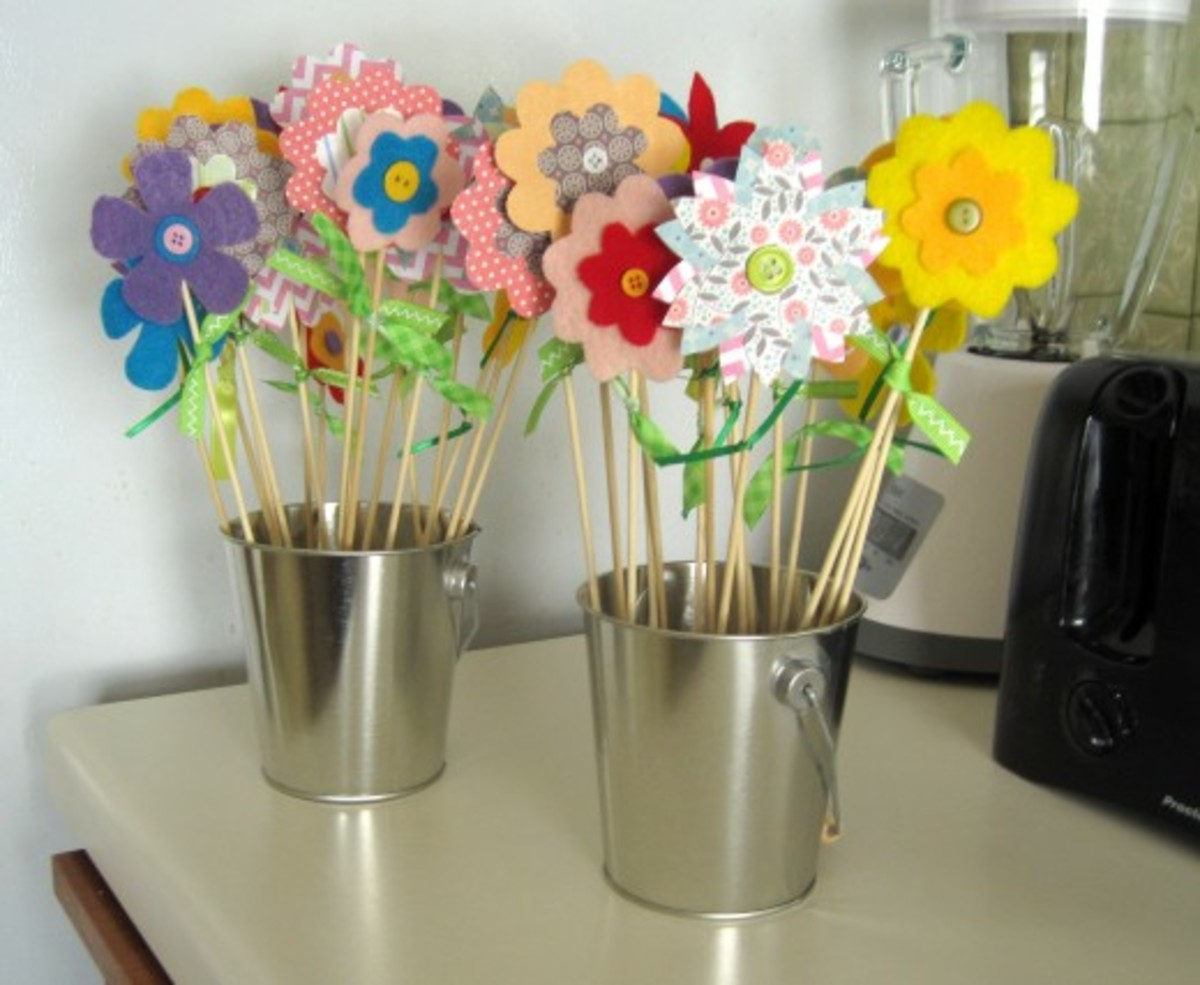 Paper and felt / fabric flowers are simple, affordable, and cheerful.