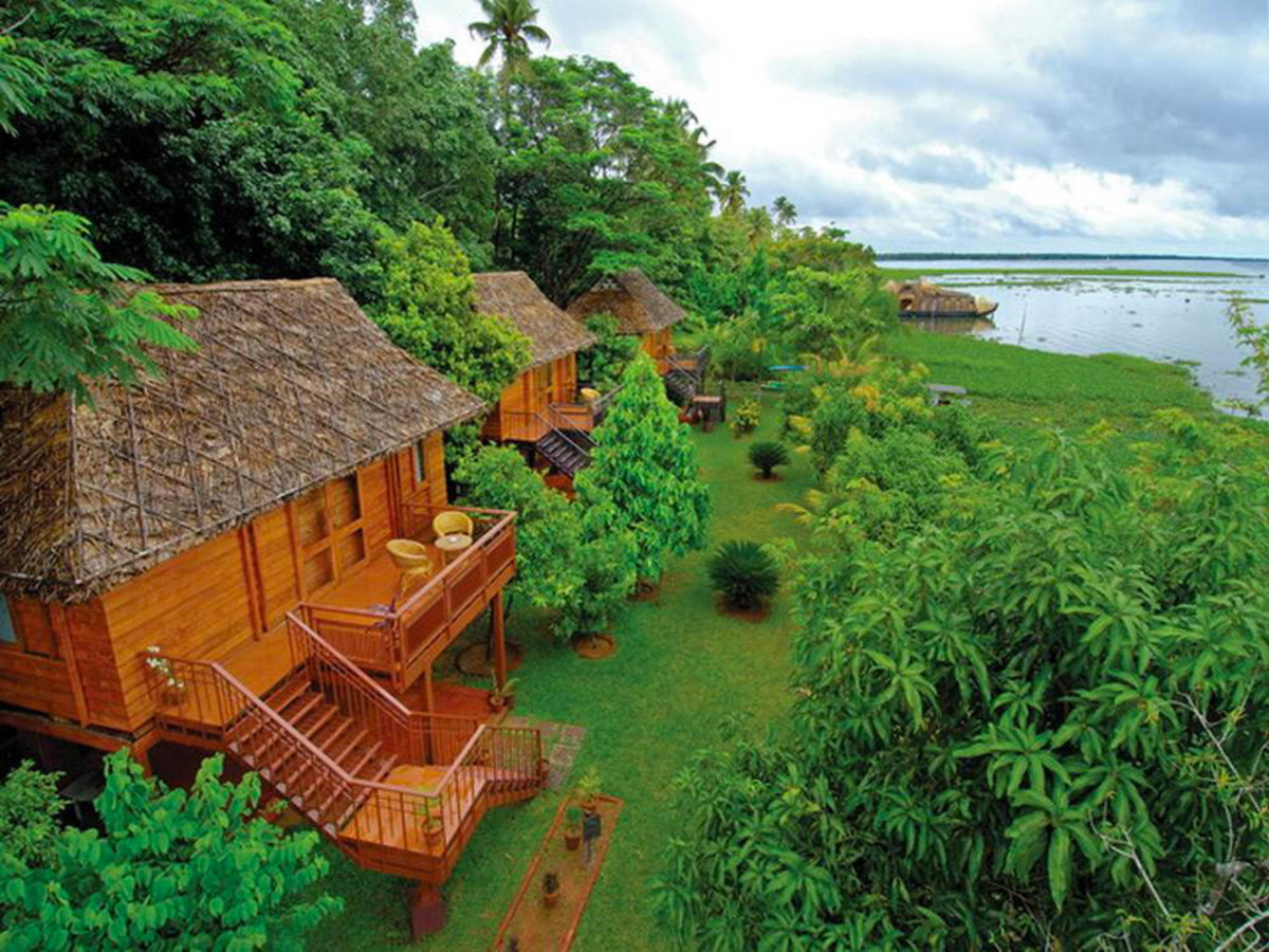 Tourist Huts Built Near The Backwaters In Kumarakom.