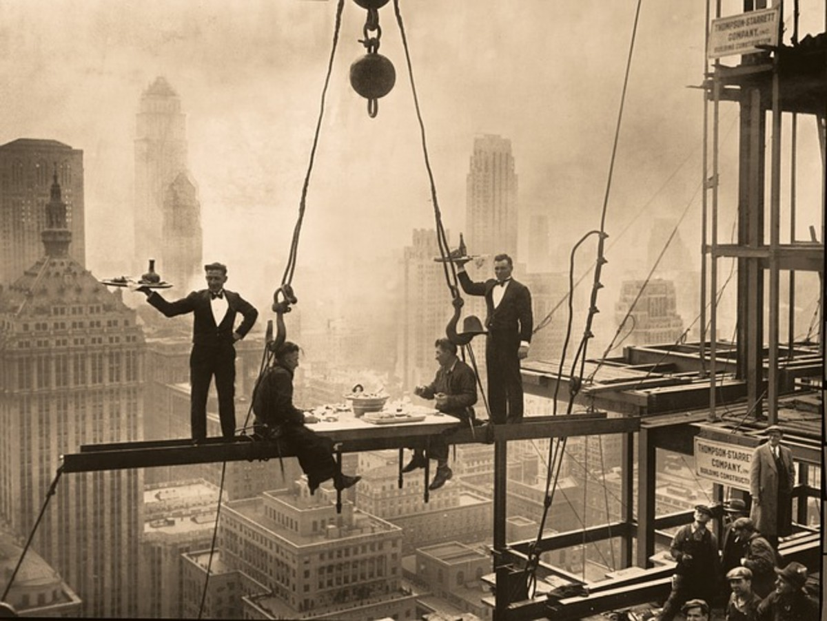 "Stunt by the Waldorf Astoria Hotel many years ago. In the 2010s a modern company began hosting dinners on tables suspended by cranes, calling them ""Dinner In the Sky."""