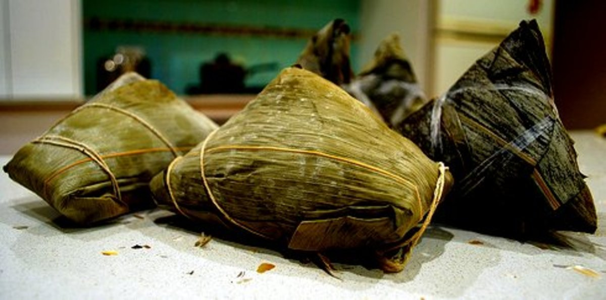 Zongzi, made of glutinous rice stuffed with various fillings and wrapped in bamboo leaves, eaten during Dragon Boat Festival period