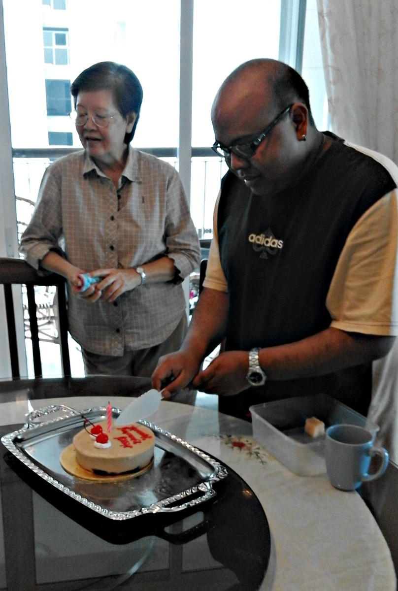 Another surprise birthday cake presented by relatives on Ken's birthday.