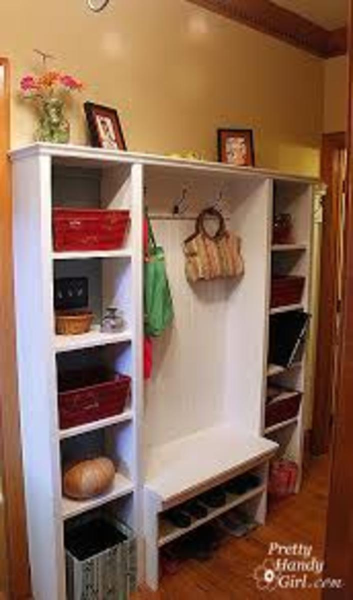 Individual cubbies with open center space for hanging clothes.  Storage under bottom shelf for shoes.