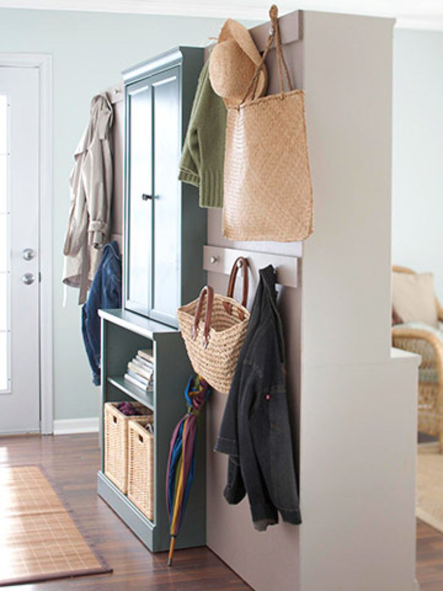 Smart options. Reverse 2 cabinets to create space in both rooms as it also adds a divider.  Add hooks to the back for hanging articles.