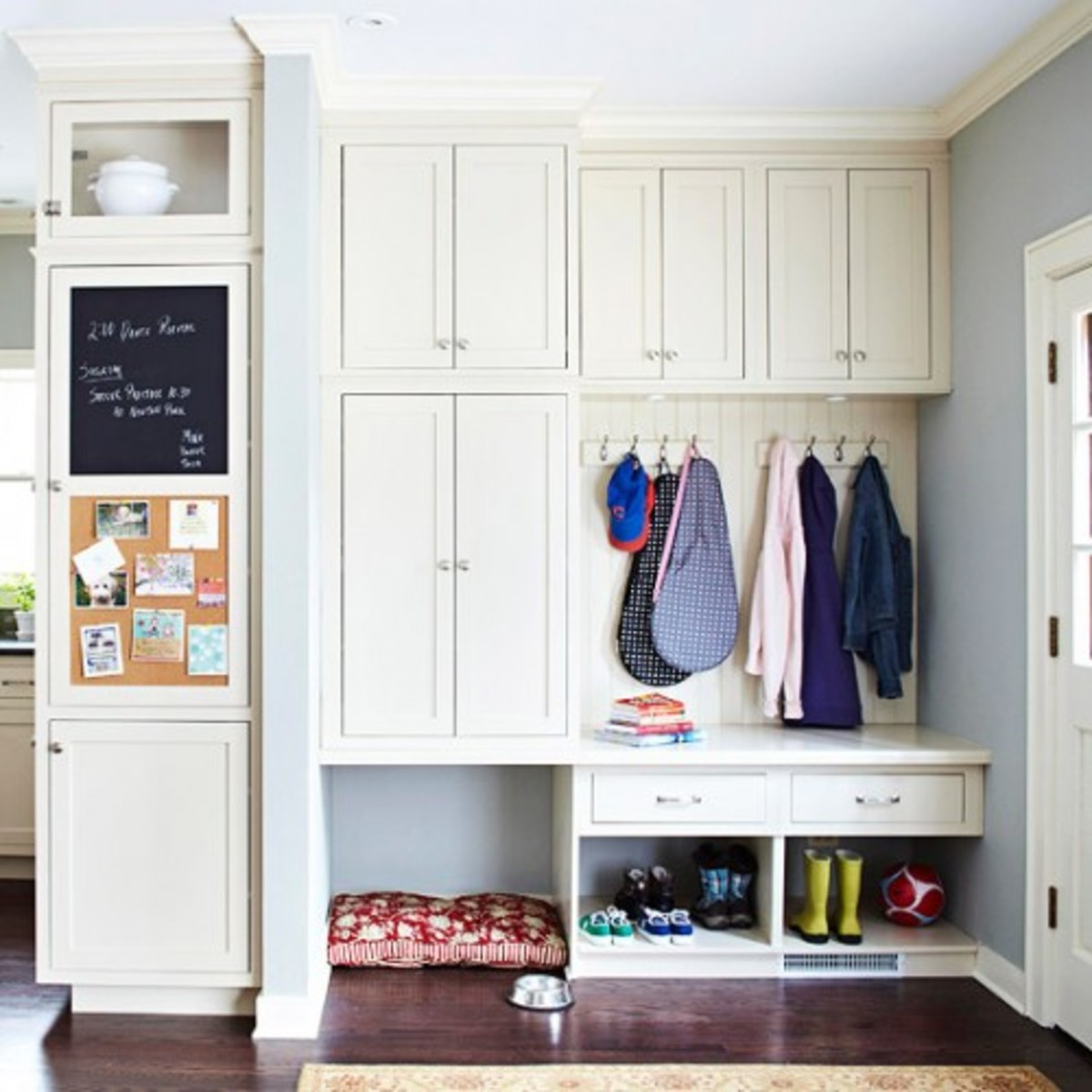 A combination of closet, cabinet, drawers, hooks and shelves.  This is my favorite idea.  Everything works and it still looks neat.