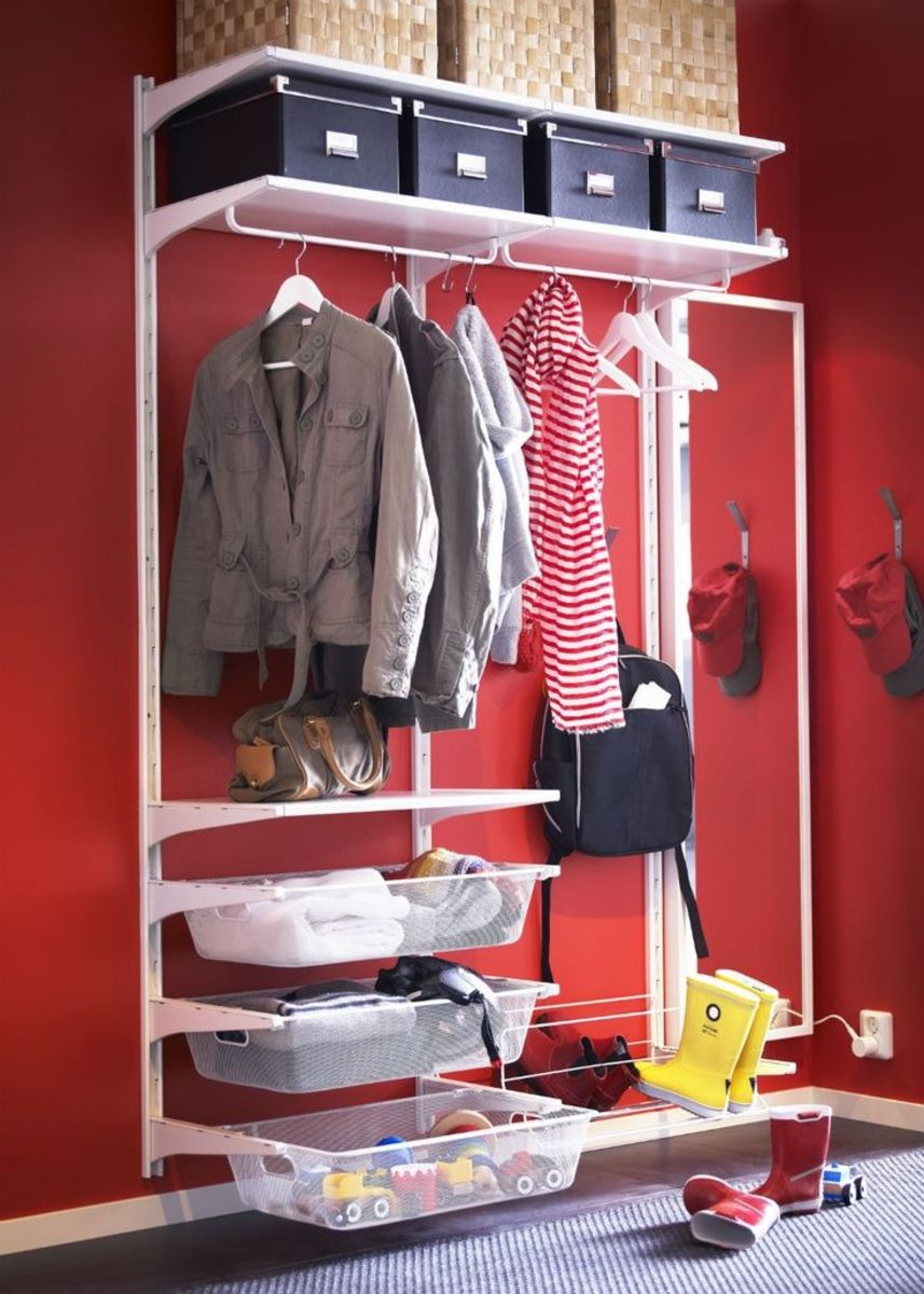 Metal unit with brackets create this open closet hallway space.  Clothes rod, shelves, baskets and slide baskets.
