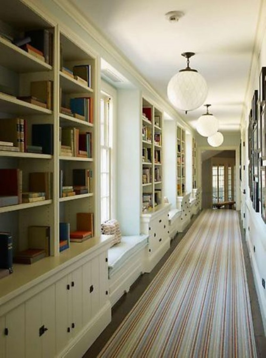 Most don't have hallways this long, but we can use this idea of shelves and drawers with windows in between.