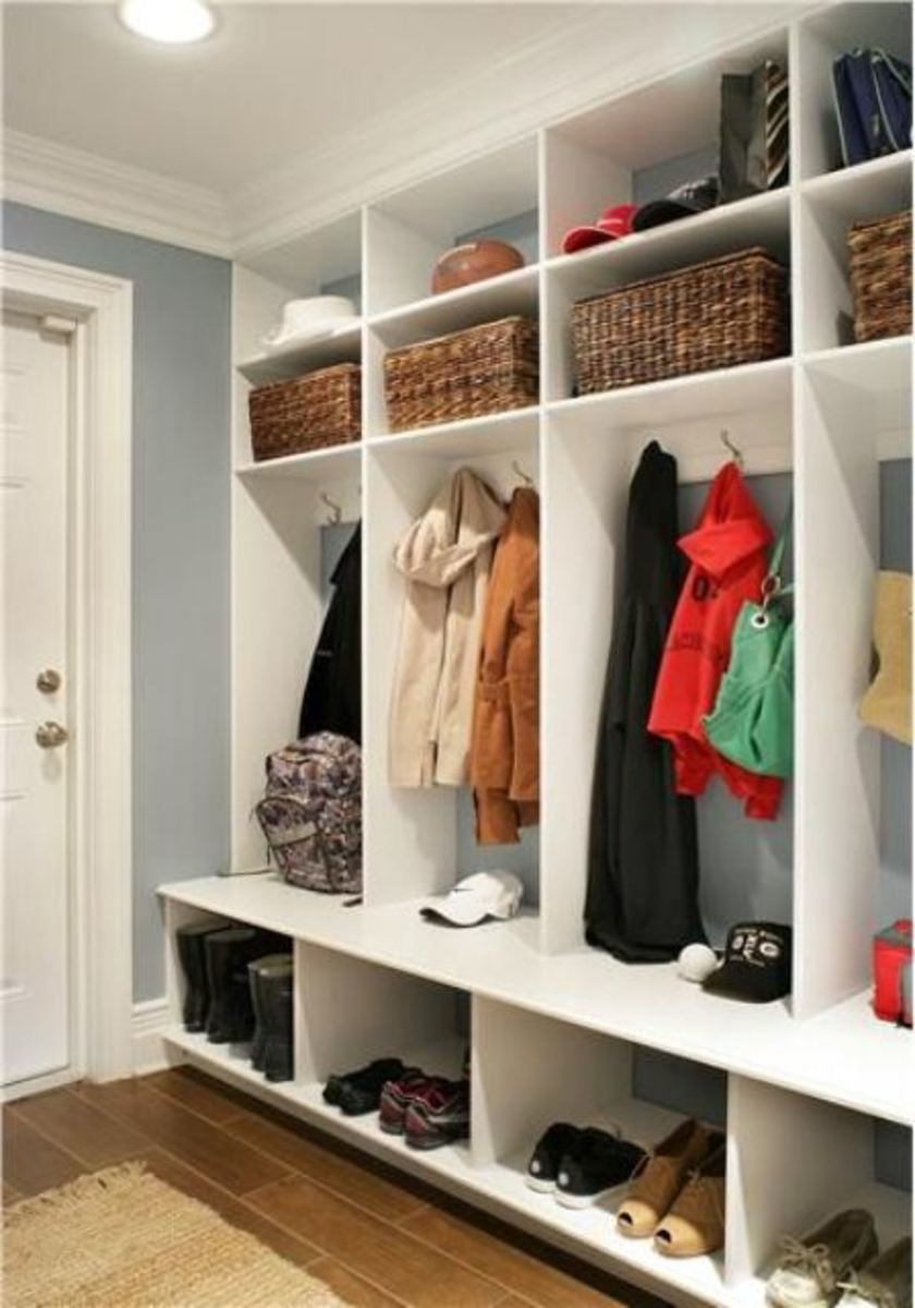 In less than a 2 ft. deep wall, you can create a 16 section clothing space for the family.  Ceiling to floor unit uses all the space available.