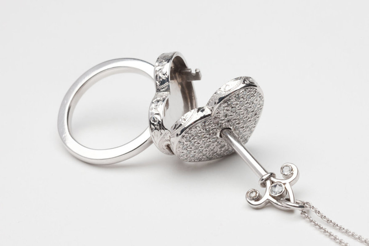 Unique heart shaped finger ring with key to the heart.